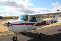 Vera is learning to fly a Cessna 150 like this one, only a bit older and more beat up!